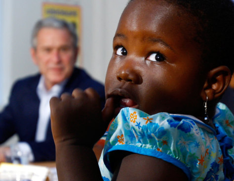 Image: Child attends a roundtable session with U.S. President Bush in Dar es Salaam