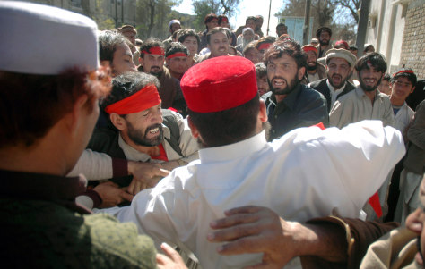 Image: Supporters of a losing political candidate scuffle