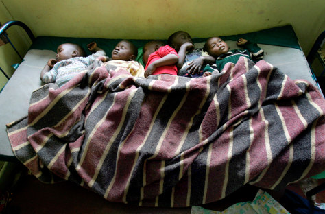 Image: Orphans children sleep on a single bed