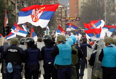 Image: Serb protesters face riot police in Mitrovica, Kosovo.