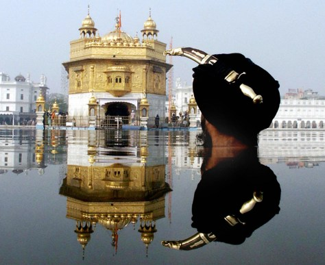 Indian Sikh devotee wears a kirpan in hi
