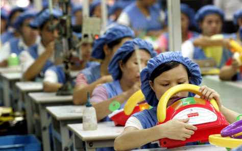 Image: Workers assemble toy cars on the production line in China.