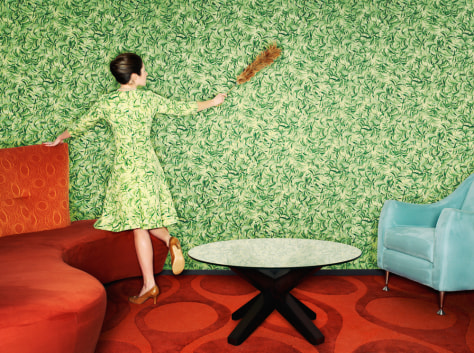 Image: Woman dusting wallpaper