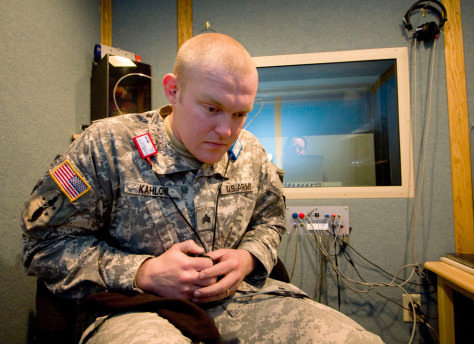 Image: U.S. Army Sgt. Ryan Kahlor listens for sounds as his hearing is tested