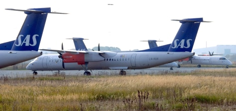 Image: Four Scandinavian Airlines Bombardier Q400 turboprop aircrafts