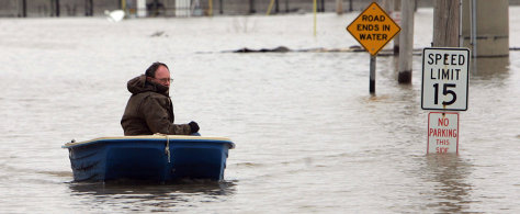 Image: Man in boat on flooded road