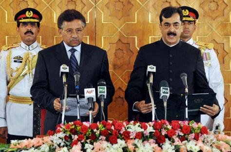 Image: Pakistani President Pervez Musharraf administrates the oath to newly elected Pakistani Prime Minister Yousuf Raza Gilani