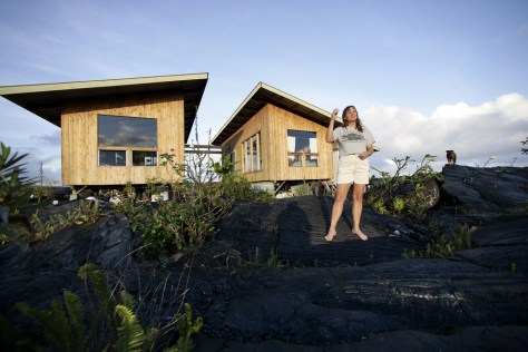 Image: Jean Olson with her house on a lava field.