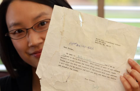 Image: Emily Shih, formerly Emily Hwaung, holds the note sent in a 1987 class project that was recently found in Alaska