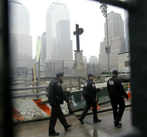 Image: Port Authority police patrol ground zero at the World Trade Center site in New York