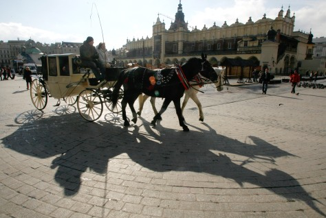 Image: Tourists in a horse-driven cab in Krakow, Poland