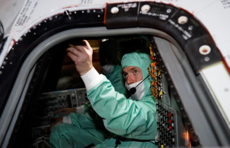 Image: Commander examines shuttle window