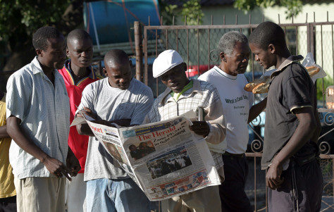 Image: Zimbabweans look for election results