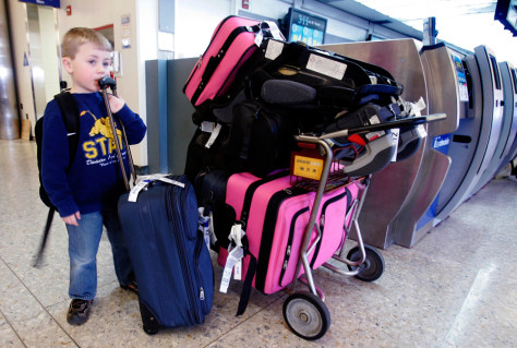 Image: Boy with luggage in airport
