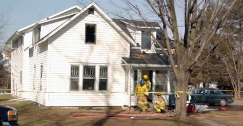 Image: Menomonie firefighters work the scene of a fatal fire