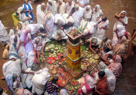 Image: Hindu widows offer prayers at the Lingaraj Temple to mark the end of a month long festival of Kartik Purnima