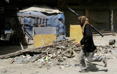 Image: A militiaman holding a RPG