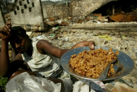 Image: A Haitian woman with rice