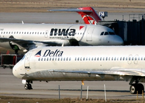 Image: Delta Airlines and Northwest Airlines jets at the Minneapolis St.Paul International Airport in Minnesota
