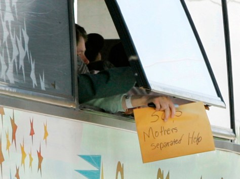 Image: FLDS mother holds sign