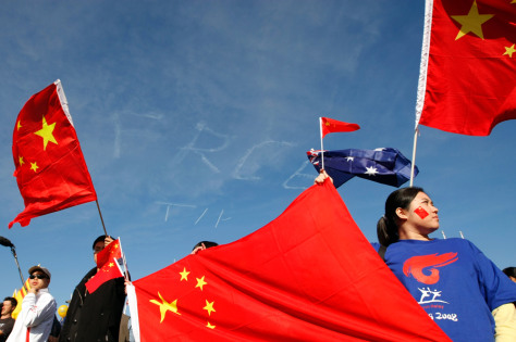 Image: Protesters wave flags
