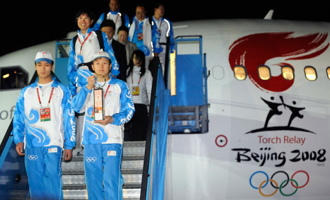 Image: The Olympic torch arrives in Pyongyang, North Korea