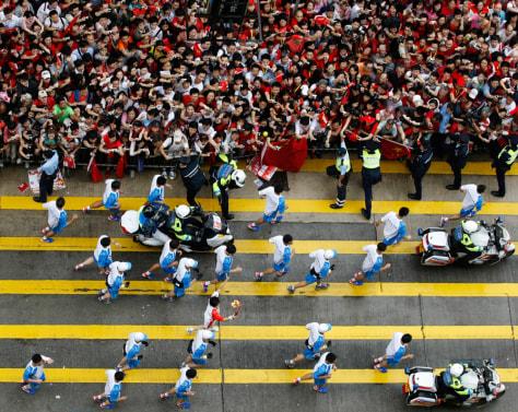 Image: The Olympic torch makes its way through Hong Kong