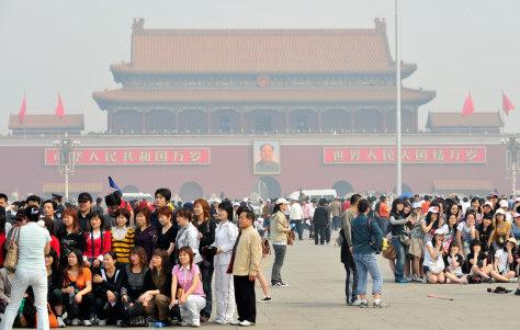 Image: Tourists visit Tiananmen Square