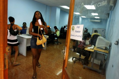 Image: A woman leaves a post office that offers Internet service in Havana