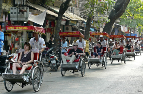 Image: Tourists take in the sites of the Old Quarter neighborhood in Hanoi, Vietnam