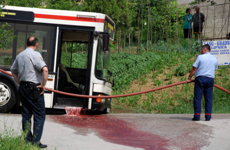 Image: Rescue service workers clean blood