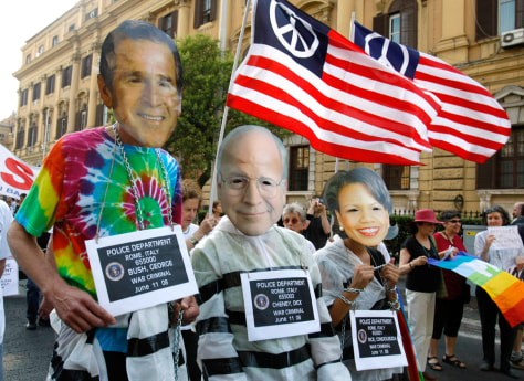 Image: Peace activists wear masks of Bush, Cheney and Rice