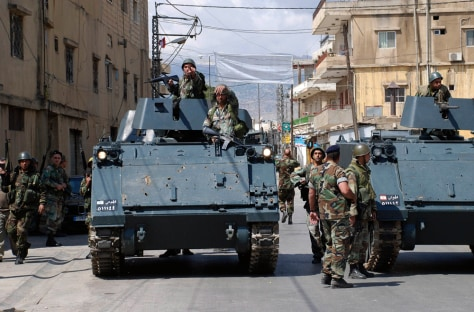 Image: Lebanese army soldiers sit on armored personnel carriers