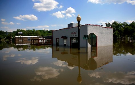 Image: Houses and businesses are surrounded by flood waters