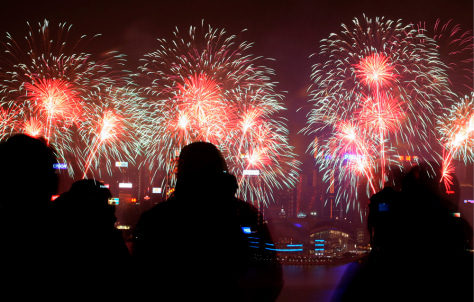 Image: Photographers take pictures of fireworks