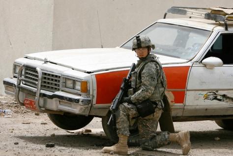 Image: U.S. soldier near car in Baghdad