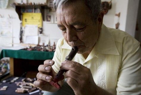 Image: Roberto Velazquez plays a replica of a flute