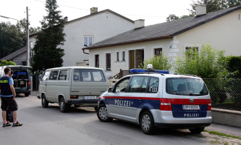 Image: Police outside a house in Strasshof, Austria