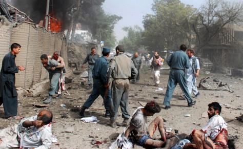 Image: Afghan security force personnel assist survivors