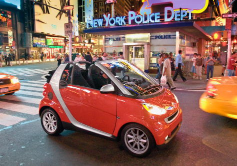 Image: A Smart car drives through New York City