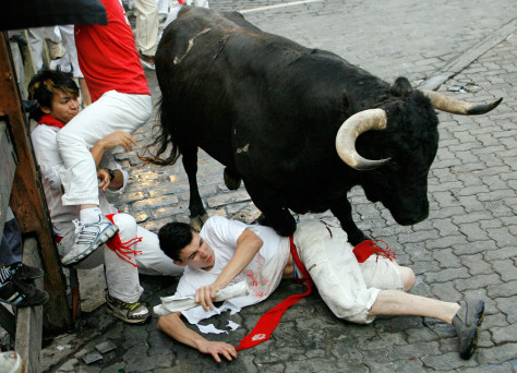 Image: Runner gets trampled in Pamplona