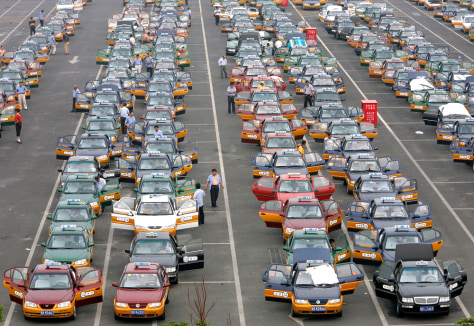 Image: Taxi drivers at Beijing Capital International Airport