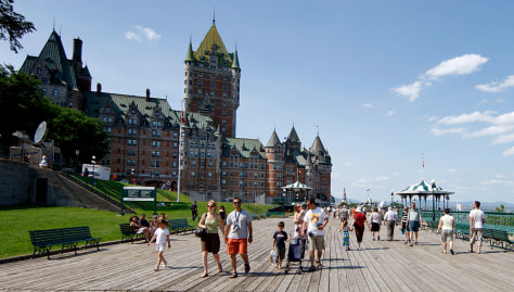 Image: People walk near the Chateau Frontenac in Quebec City