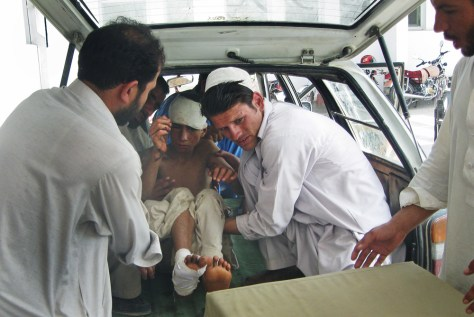 Image: Afghan hospital workers carry an injured boy out of a van