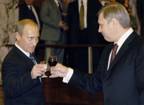 Image: Russian president Vladimir Putin toasts the prime minister