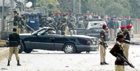 IMAGE: Pakistani soldiers guardMusharraf's motorcade