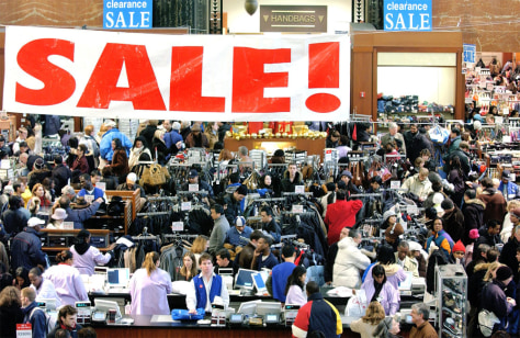 Image: Shoppers crowd stores for after Christmas bargains