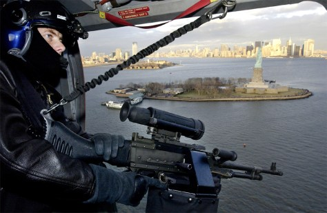 COAST GUARD PATROL OVER STATUE OF LIBERTY IN NEW YORK