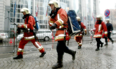BELGIAN FIREFIGHTERS WALK PAST EUROPEAN PARLIAMENT IN BRUSSELS, AFTER A LETTER BOMB EXPLODED