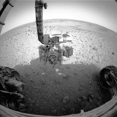 Spirit's robotic arm snaps close-up image